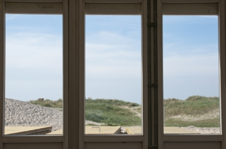 Beach view through glass window photo