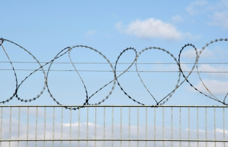 barbed wire fence: Razor and barbed wire fence.