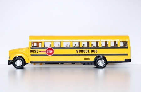 Yellow toy school bus, white background Stock Photo