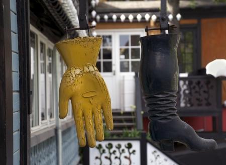 amusment: worn boot and glove Stock Photo
