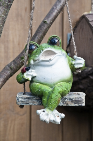 Decaration frog swings and sing. Stock Photo