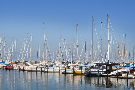 Small sailboats in a harbor Stock Photo