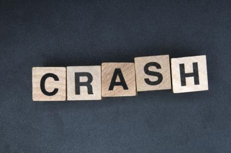 Wooden cubes spelling crash