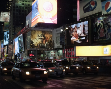 Times Square is featured with Broadway Theaters and LED signs as a symbol of New York City and the United States.