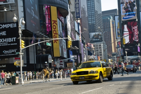 Yellow taxi cab in Times Square in New York