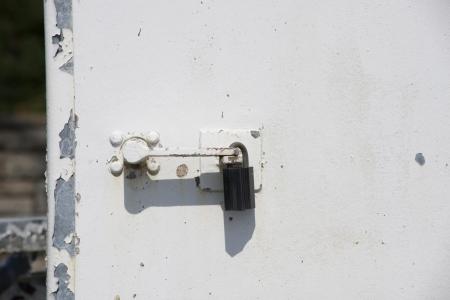 padlock on a old metal door Stock Photo