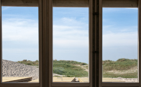 house windows looking out at the beach