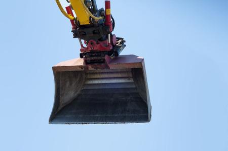 Big excavator against a blue sky Stock Photo
