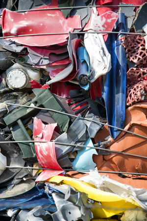 plastic in many colors ready for recycling on a junkyard