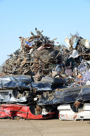 pile of used cars on a scrapyard