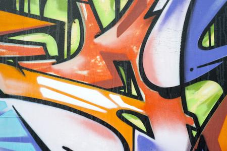 Multi coloured graffiti on a wall photo