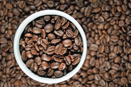 Coffee mug with coffee beans