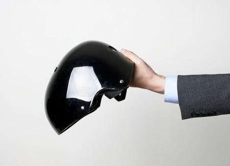 A man holding a black helmet