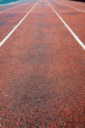 running track with white lines Stock Photo