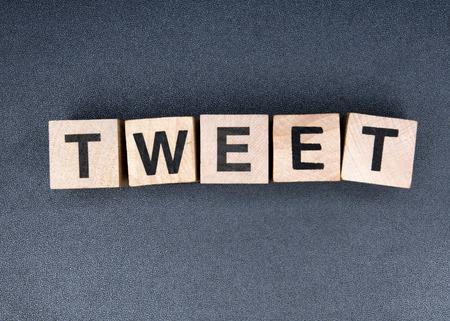 Wooden cubes spelling tweet