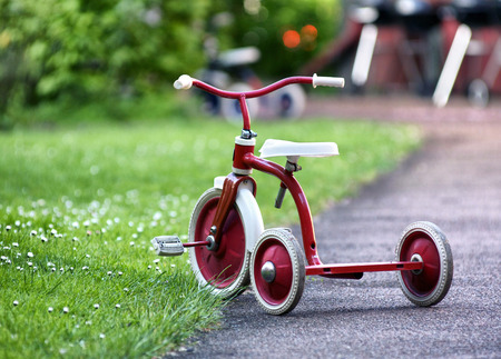 child tricycle left in the garden