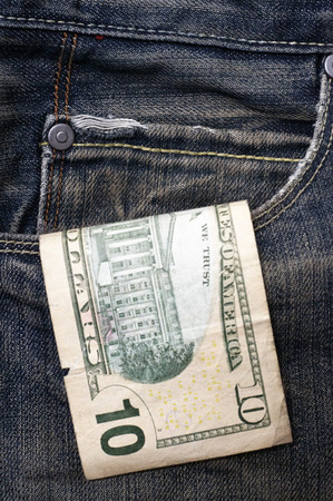 Ten dollar hanging out of a pocket