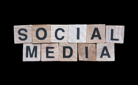Social media spelled with wooden cubes Stock Photo