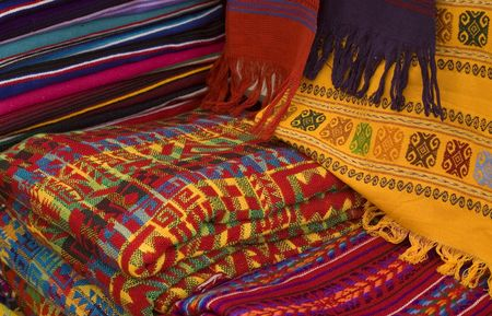 tourism in belize: Colorful Mayan and Mexican Fabrics for sale in a Market in Chiapas, Mexico Stock Photo