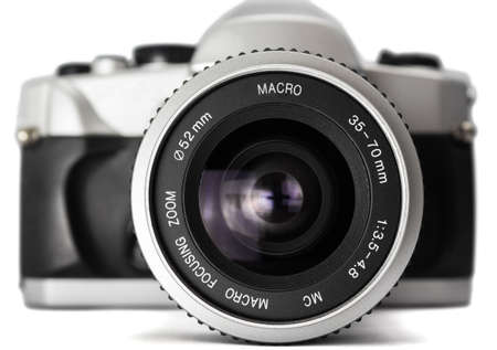 analog camera: closeup of an analog camera silver. view from the front