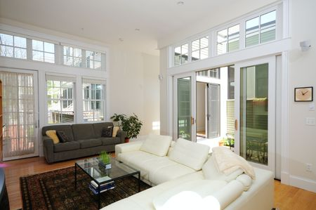 condominium: Modern home interior. Open plan living room and atrium.