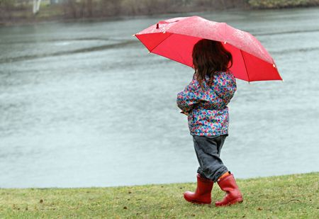 Little girl in the rain with red boots and umbrella Reklamní fotografie - 3243452