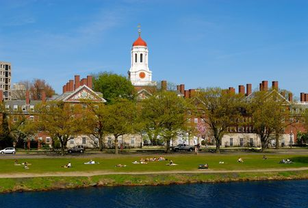 Spring view of Harvard University students relaxing on Charles River bank photo