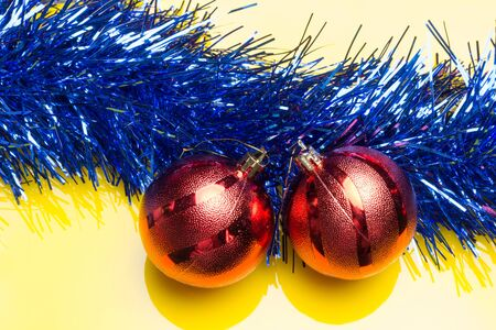 Red balls and tinsel, to decorate the Christmas trees and the interiors of the house to receive the Christmas holidays and the new year with family and loved ones