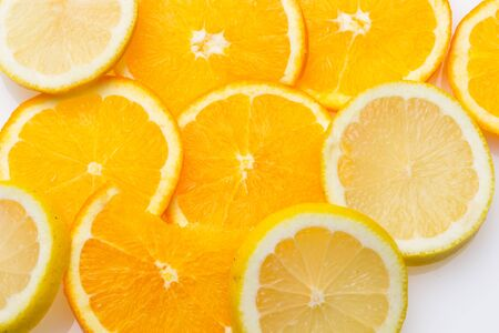 Slices of oranges and lemons, fruits full of juice with which juices are made, the sweetest orange than the lemon that is much more acidic, both full of vitamins C and very healthy