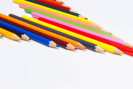 Colored pencils with a sharp point ready to draw and paint drawings; color with colors; color range from white to black through the entire color range, yellow, pink, green, blue, red, brown.