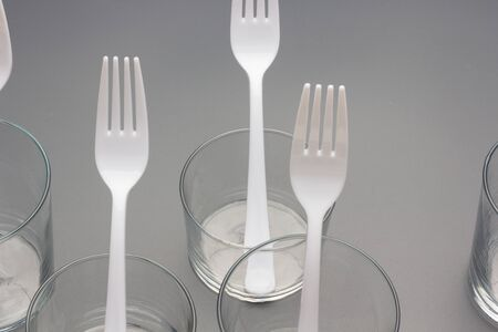 Forks of white color and constructed with recyclable plastic material, to prick Picnic food among friends and family.