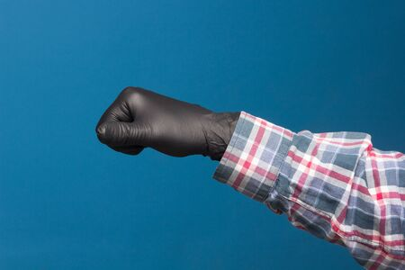 Hygienic hand protection, fine black glove to avoid losing touch in the hands. Hand and finger signs. Stockfoto