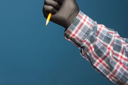 Color pencil with black hygienic protection glove on blue background. Pencil for drawing. pencil with sharp point