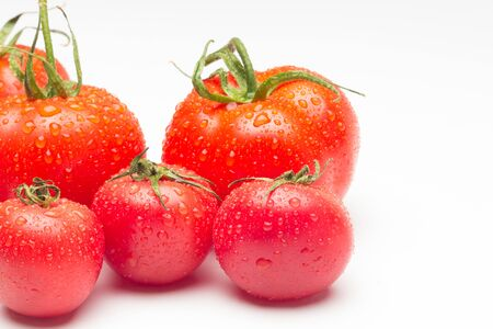 Tomatoes and apples, red fruits, for salads to eat raw, full of vitamins and few calories ideal for dieting.