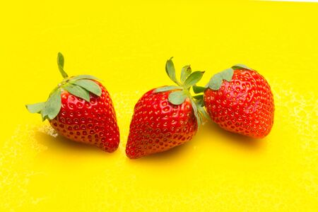 Red strawberries, rich in vitamins, eaten raw, in jam, in ice cream, few calories, sweet taste. Stock Photo