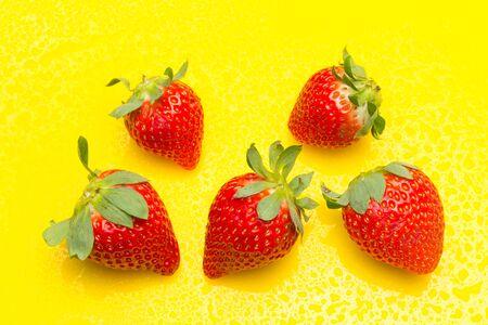 Red strawberries, rich in vitamins, eaten raw, in jam, in ice cream, few calories, sweet taste. Stock Photo