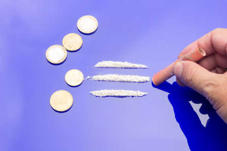White powders, lines of white powders, addictive, dangerous and illegal drug. Traffic in dangerous substances, mafias. Drug trafficking, substance use. Consumption of drugs. Drug addiction.