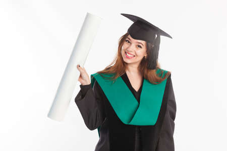 Study, education, university, college, graduate concept on banner. Happy and excited portrait of young student girl in hat of graduation isolated 免版税图像