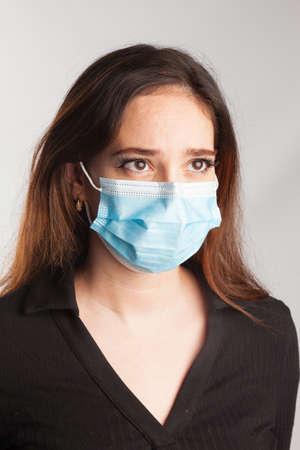 Young girl wearing a surgical mask to prevent being infected with Covid19 and to protect herself from the virus.