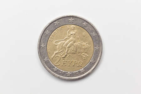 Official coin of two euros of the European Economic Community. Legal tender metal coin with different images depending on the country that issues the coin.
