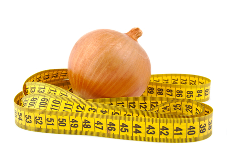 Onion and tape measure on a bright background photo