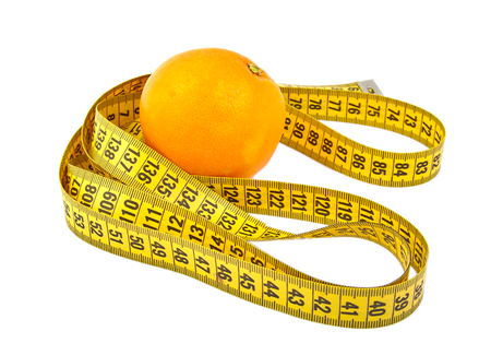 Orange and a tape measure isolated on white photo