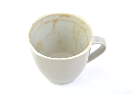 Dirty and empty coffee cup photo