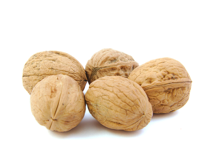 strooigoed: Close-up of five nuts on white background