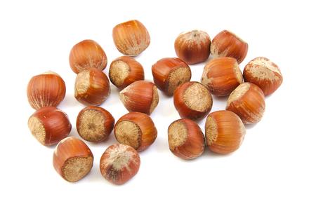 handful: Handful of hazelnuts on white background Stock Photo