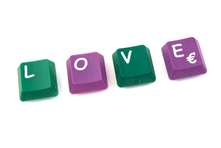 Love word formed with computer keys on white background photo