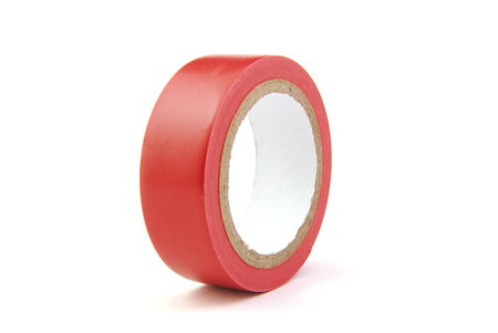 Red insulating tape on white background photo