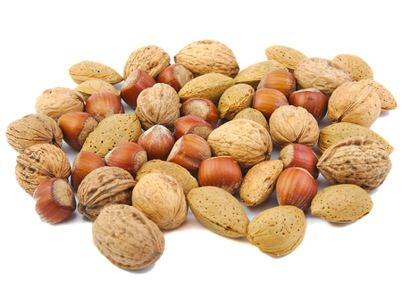 pista: Mixed nuts: walnuts, almonds and hazelnuts on white background