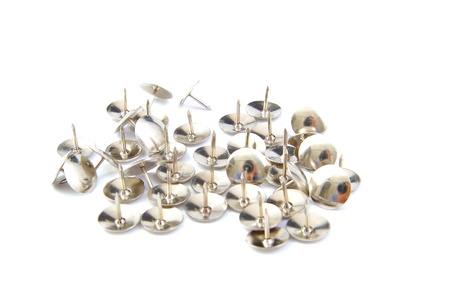 Bunch of thumbtacks on a white background photo