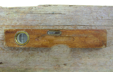 Old vintage wooden water level on wood background photo
